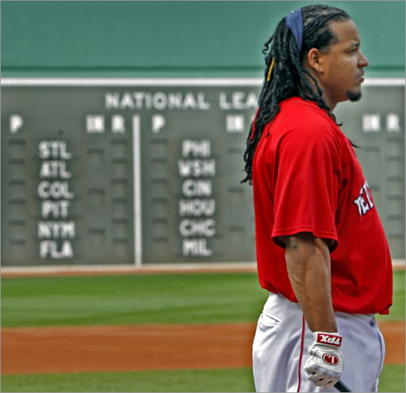 Will he stay or will he go? By Thursday afternoon's trading deadline, Red Sox LF Manny Ramirez (shown during batting practice at right) could be playing for one of the teams shown on the scoreboard, or he could be staying put in Boston.