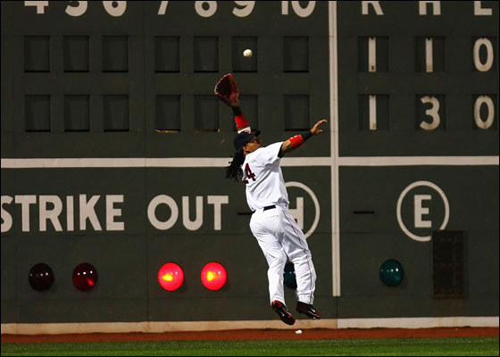 Manny Ramirez of the Boston Red Sox catches a ball hit by Kenny Lofton of the Cleveland Indians during Game One of the American League Championship Series at Fenway Park 12 October 2007 in Boston, Massachusetts.
