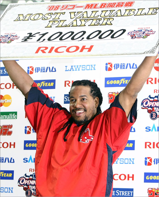 Outfielder Manny Ramirez #24 of Boston Red Sox holds up the MVP award for the first game of the MLB Opening Series against Oakland Athletics at Tokyo Dome on March 25, 2008 in Tokyo, Japan. Boston Red Sox defeated Oakland Athletics by 6-5.