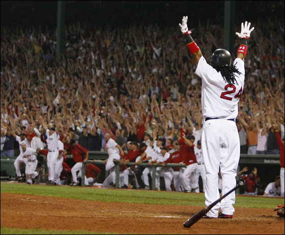Manny Ramirez f the Boston Red Sox celebrates after connecting for a three-run home run to defeat the Los Angeles Angels, 6-3, in Game 2 of the American League Division Series at Fenway Park October 5, 2007 in Boston, Massachusetts. (Photo by Jim Rogash/Getty Images)