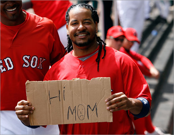 Outfielder Manny Ramirez of the Boston Red Sox holds a sign during the delay of the Grapefruit League Spring Training game against the Toronto Blue Jays on March 19, 2008 at City of Palms Park in Ft. Myers, Florida. The Red Sox players unanimously voted to not play their last Spring Training game in Florida and not get on the plane to Japan in a dispute over whether coaches and staff are paid a $40,000 stipend for the trip to Japan.