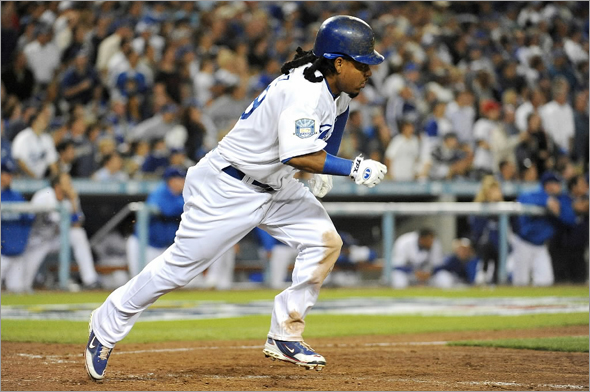 Manny Ramirez of the Los Angeles Dodgers hits a double in the eighth inning against the Philadelphia Phillies in Game Four of the National League Championship Series during the 2008 MLB playoffs on October 13, 2008 at Dodger Stadium in Los Angeles, California.