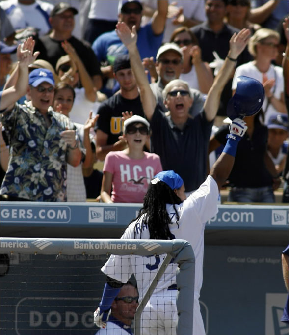 Manny Ramirez tips his batting helmet to the crowd as they cheer his solo home run in the fifth inning during an MLB baseball game against the Arizona Diamondbacks, Sunday, Aug. 3, 2008 in Los Angeles.
