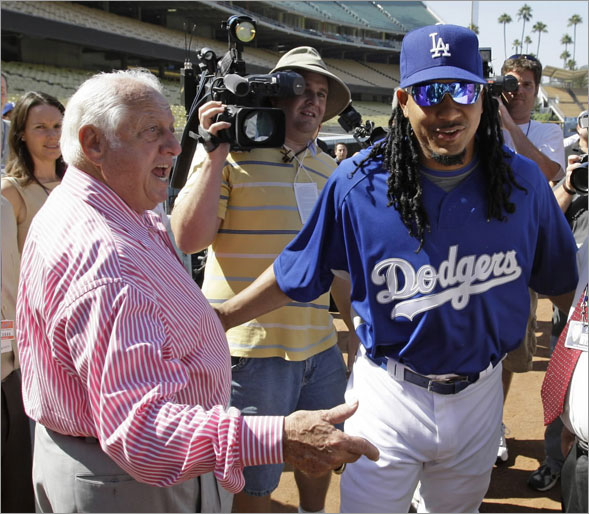 Former Los Angeles Dodgers manager Tommy Lasorda greets the teams newest player, Manny Ramirez on his way to a news conference before the Dodgers baseball game against the Arizona Diamondbacks in Los Angeles, Friday, Aug. 1, 2008.
