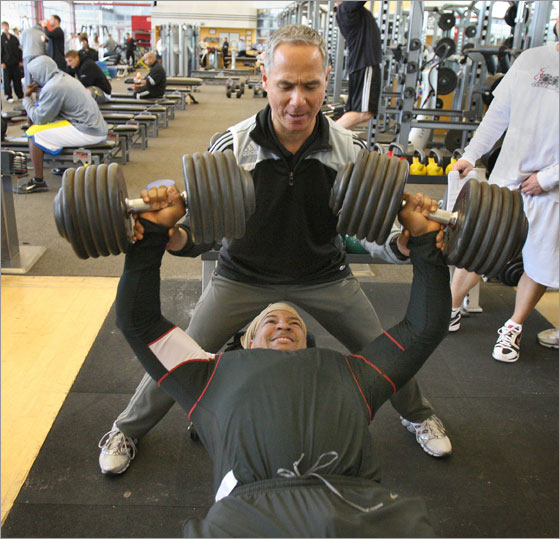 Manny Ramirez  lifts a  pair of 110 pound dumbells at  Athletes' Performance in Tempe, AZ under the direction of performance specialist Darryl Eto.