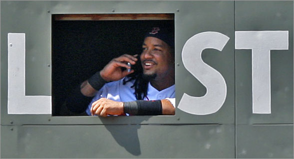 During a sixth inning pitching change, when Red Sox starting pitcher Josh Beckett was removed from the game, Red Sox leftfielder Manny Ramirez went inside the Green Monster, and was seen smiling and apparently talking on someone's cellphone.