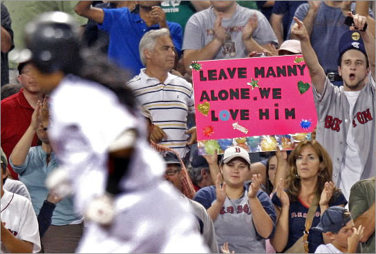 07/28/08: As Red Sox LF Manny Ramirez rounds third base following his bottom of the ninth inning solo home run, a fan holds a sign reading