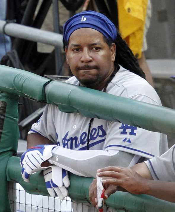 Manny  Ramirez watches the final out of the ninth inning from the dugout during a baseball game against the Pittsburgh Pirates in Pittsburgh, Monday, April 5, 2010.
