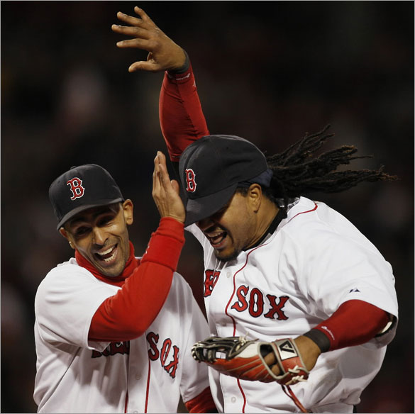 Manny Ramirez, right, is congratulated by teammate Julio Lugo after Ramirez threw out Tampa Bay Rays' Carlos Pena at home plate during the fourth inning of a baseball game at Fenway Park in Boston, Saturday, May 3, 2008.