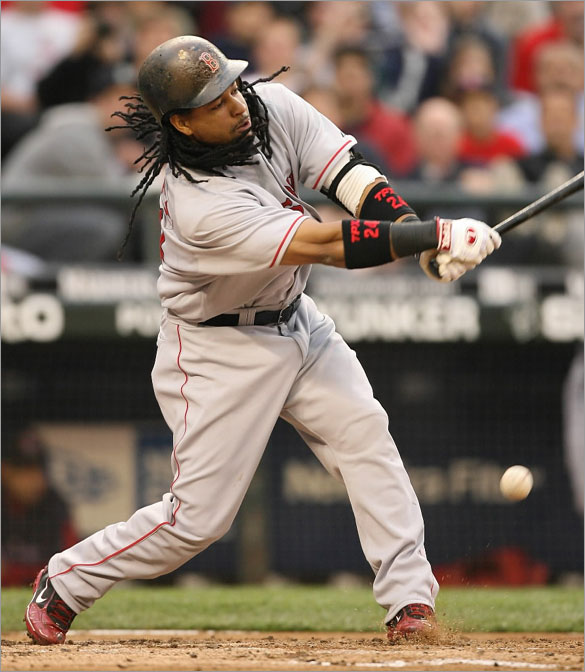 Manny Ramirez of the Boston Red Sox swings and misses at a pitch against the Seattle Mariners on May 28, 2008 at Safeco Field in Seattle, Washington.