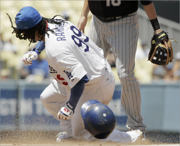Dodgers' Manny Ramirez steals second base as Colorado Rockies second baseman Jeff Baker (10), looks on in the fourth inning of a National League baseball game in Los Angeles on Thursday, Aug. 21, 2008. It was Ramirez' first stolen base as a Dodger