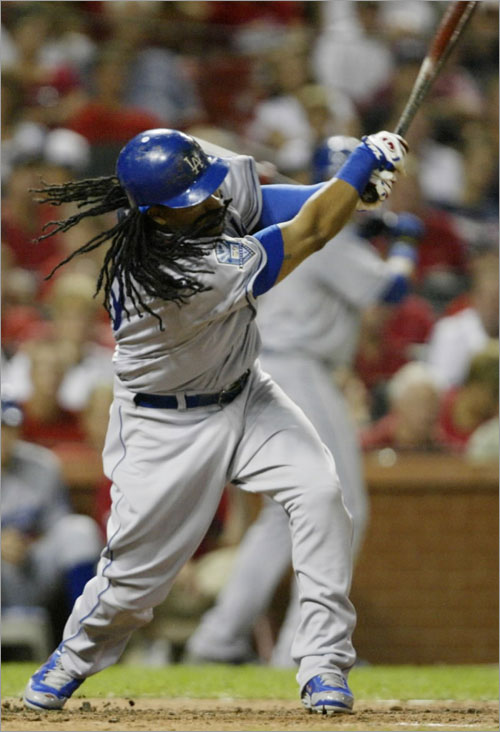 Los Angeles Dodgers' Manny Ramirez connects for a single in the fourth inning against the St. Louis Cardinals in a baseball game, Tuesday, Aug. 5, 2008 in St. Louis.