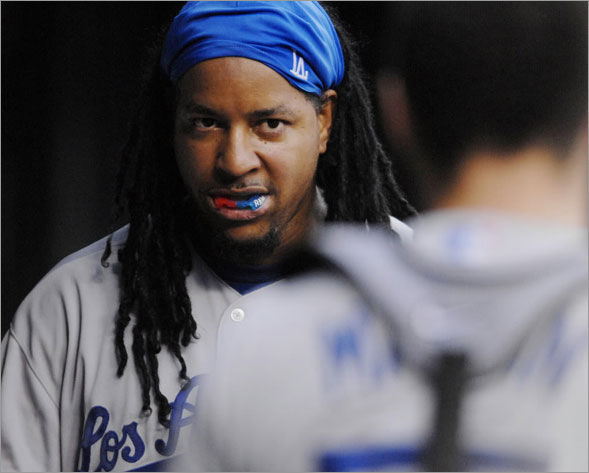 Los Angeles Dodgers' Manny Ramirez looks towards catcher Russell Martin as Ramirez is congratulated after hitting his second-inning inning solo home run during their baseball game against the St. Louis Cardinals on Wednesday, Aug. 6, 2008, in St. Louis.