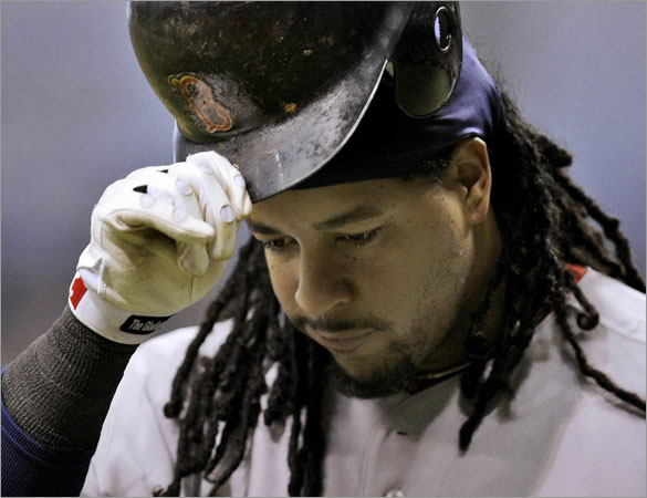 Manny Ramirez removes his helmet after being stuck out by Tampa Bay Rays' Matt Garza during the second inning of a baseball game Tuesday, July 1, 2008, in St. Petersburg, Fla. The Rays defeated the Red Sox 3-1.