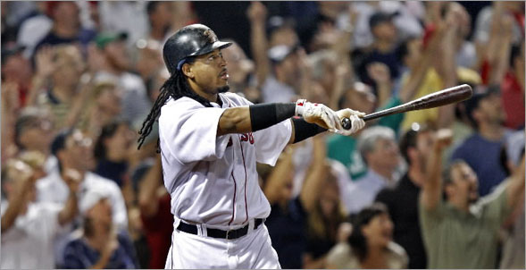 Red Sox DH Manny Ramirez brings the crowd out of their seats as they all watch his game tying eighth inning home run sail out of the park.