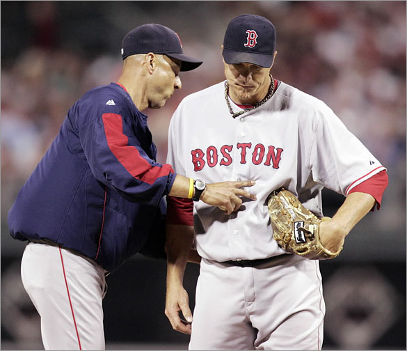 Red Sox manager Terry Francona, left, pats pitcher Mike Timlin as he is taken out of the game in the sixth inning after giving up four runs to the Philadelphia Phillies in an baseball game Monday, June 16, 2008, in Philadelphia. The Phillies won 8-2.