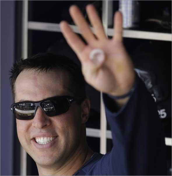 Mark Teixeira waves to fans from the dugout before taking batting practice before playing the Cleveland Indians in a Major League Baseball game Saturday, April 18, 2009 at Yankee Stadium in New York.