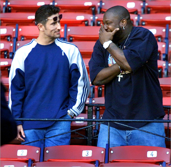 9-26-2001: Former Red Sox first baseman Mo Vaughn (right) was a visitor at Fenway Park during Boston's batting practice. He got together in the stands and had a few laughs with ex-teammate Nomar Garciaparra.