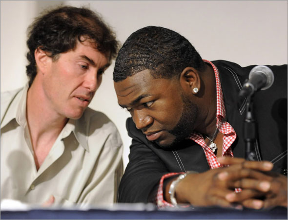 Michael Weiner, general counsel to the Major League Players Association, consults with Boston Red Sox player David Ortiz at a news conference at Yankee Stadium