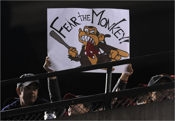 A fan of the Los Angeles Angels of Anaheim holds up a sign for the rally monkey during Game Two of the ALDS during the 2009 MLB Playoffs against the Boston Red Sox at Angel Stadium on October 9, 2009 in Anaheim, California. The Angels won the game 4-1.