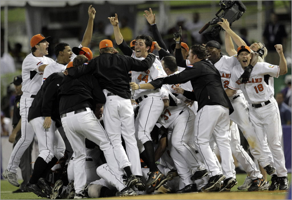 Netherlands' players celebrate after defeating the Dominican Republic 2-1 in the tenth inning of a World Baseball Classic game in San Juan, Tuesday, March 10, 2009. Netherlands advanced to round 2, and the Dominicans were eliminated.