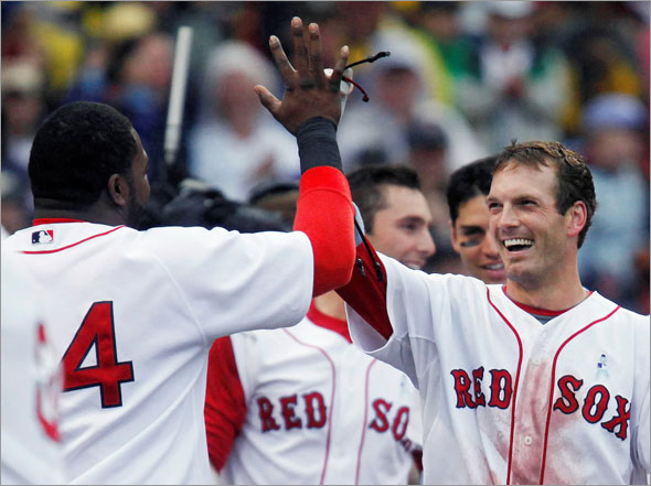 Boston Red Sox's Nick Green, right, celebrates his walk-off home run in the ninth inning of a baseball game with David Ortiz, left, Sunday, June 21, 2009, in Boston. The Red Sox won 6-5.