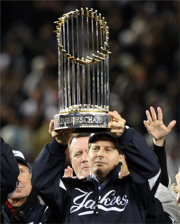 New York Yankees Managing General Partner Hal Steinbrenner of the New York Yankees celebrates with the trophy after their 7-3 win against the Philadelphia Phillies in Game Six of the 2009 MLB World Series at Yankee Stadium on November 4, 2009 in the Bronx borough of New York City.