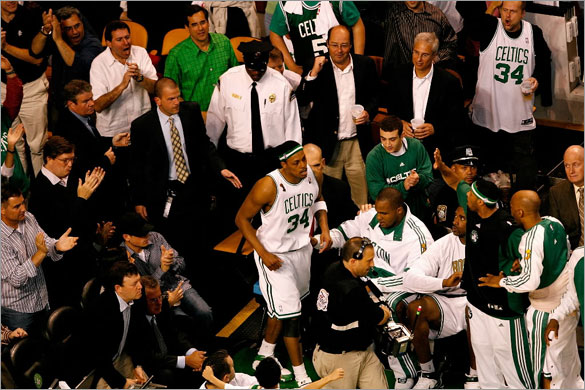 Paul Pierce of the Boston Celtics returns to the court after being taken off in a wheelchair in the third quarter of Game One of the 2008 NBA Finals against the Los Angeles Lakers on June 5, 2008 at TD Banknorth Garden in Boston, Massachusetts