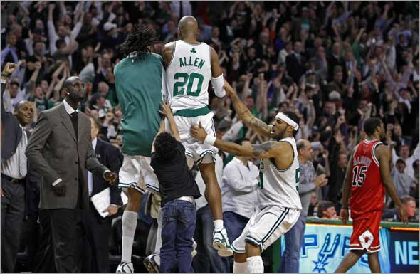 The Celtics Ray Allen won the game with a three pointer in the final seconds of the game, 118-115. Here he is mobbed by his teammates, Kevin Garnett is at left, the Bulls John Salmons walks off the court at right fter the final buzzer sounded.