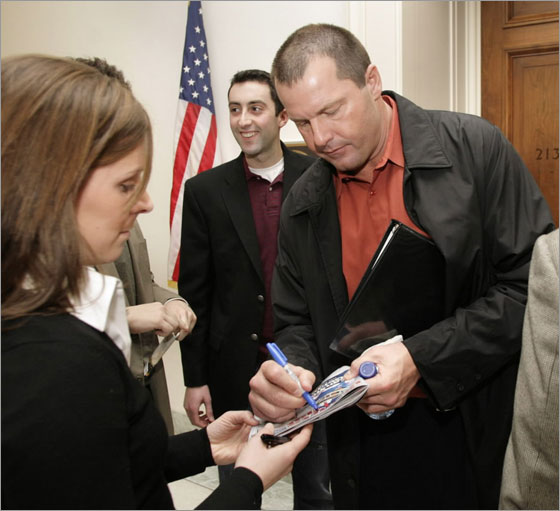 Major League Baseball pitcher Roger Clemens signs autographs after his meeting with Rep. Eleanor Holmes Norton (D-DC) on Capitol Hill in Washington