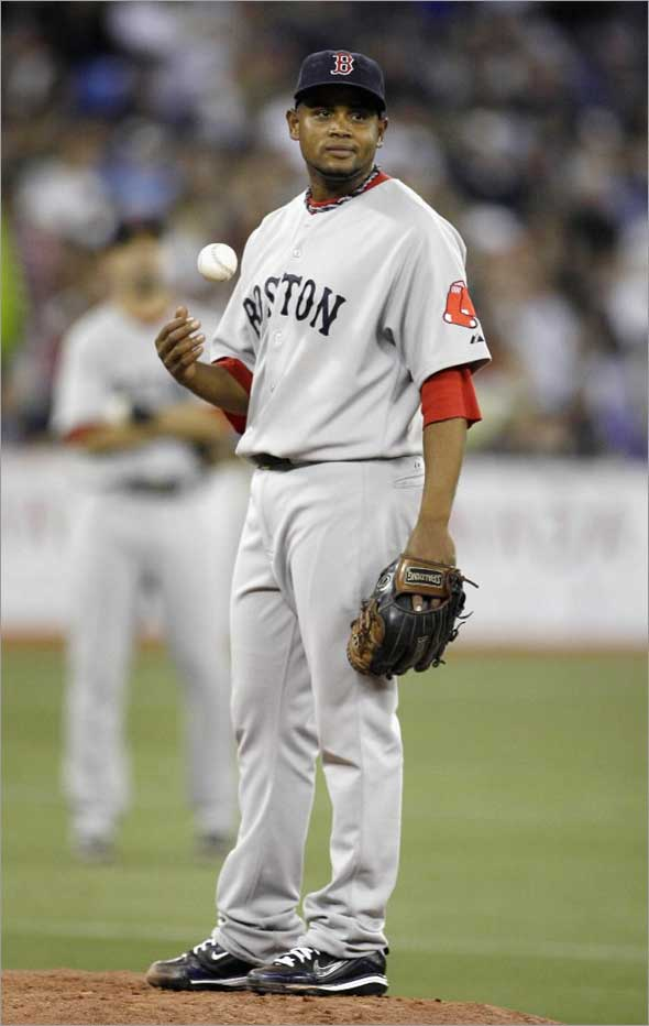 Red Sox pitcher Ramon Ramirez waits to be pulled after giving up the go ahead runs to the Toronto Blue Jays during the seventh inning of their MLB American League baseball game in Toronto, May 30, 2009.