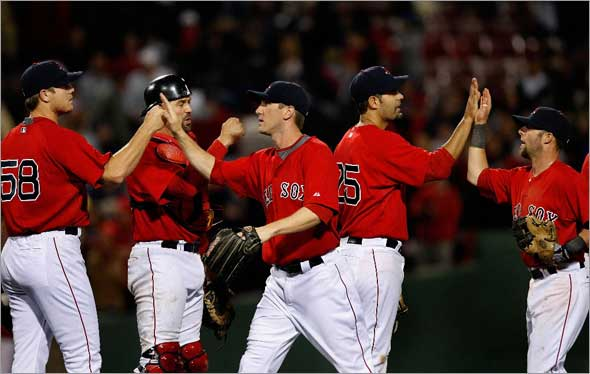 The Boston Red Sox celebrate a much needed win and a great comeback against the Orioles in Game 1 of the series after a bad beginning by Boston Red Sox starting pitcher Brad Penny, not pictured.