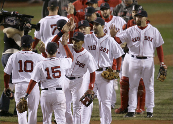 The Boston Red Sox celebrate their 10-3 win over the Cleveland Indians in Game 1 of the American League Championship baseball series Friday, Oct. 12, 2007, at Fenway Park in Boston.