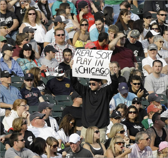 A Chicago White Sox fan holds up a sign during the ninth inning of a baseball game against the Boston Red Sox, Saturday, Sept. 5, 2009, in Chicago.