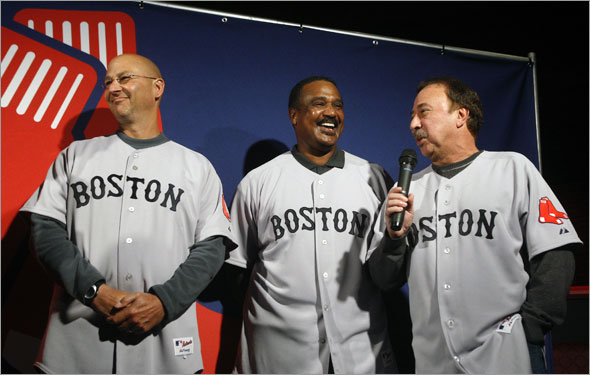 At an event held in the basement of the Game On restaurant, the Boston Red Sox unveiled an updated logo, as well as new primary road uniforms, and also  a new secondary road jersey, and a new hat to go with the secondary road jersey. Here team manager Terry Francona, (left) and former players Jim Rice (center) and Jerry Remy (right) show off the new primary road jersey.