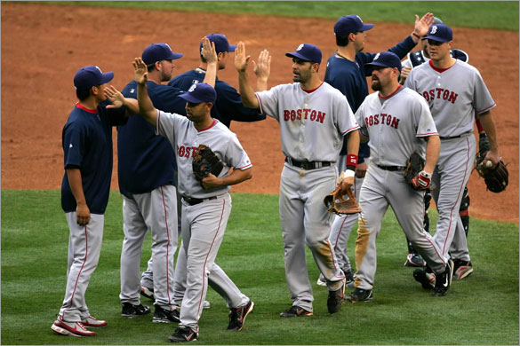 The Boston Red Sox celebrate victory over the New York Yankees on July 4, 2008 at Yankee Stadium in the Bronx borough of New York City. The Red Sox defeated the Yankees 6-3.