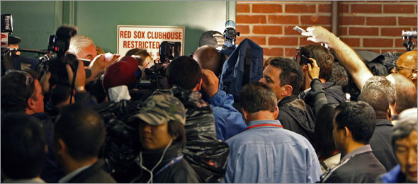 The Red Sox lost to the Blue Jays last night, and had to wait for the results of the Texas-Anaheim game to see if they can clinch the American League Wild Card playoff berth. When Texas lost on the west coast, the players celebrated in the locker room. The media was not allowed into the clubhouse, so as players came out of the door to talk, a mob scene ensued.