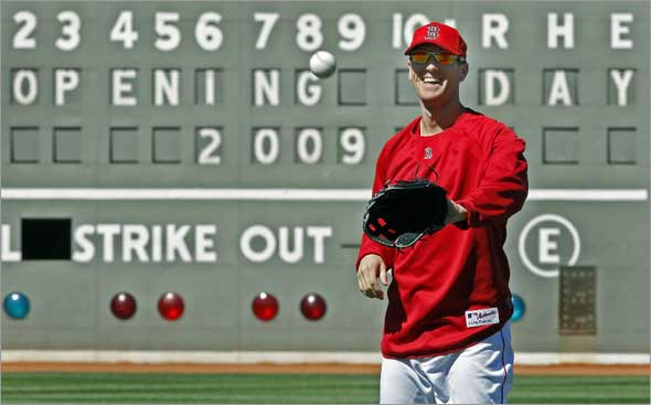 The Boston Red Sox are scheduled to open the 2009 baseball season on Monday afternoon at Fenway Park. The team held a workout this afternoon in preparation. Here leftfielder Jason Bay is all smiles as he plays catch at the start of the practice with the Green Monster  in the backround.