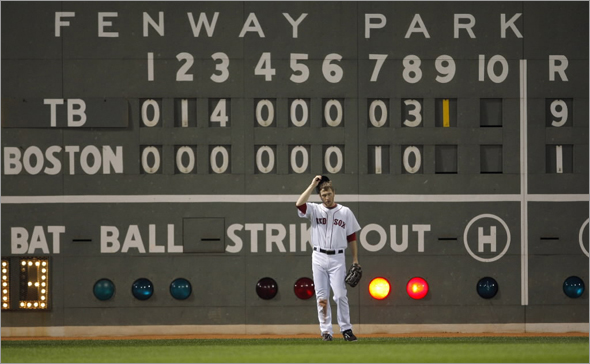 Jason Bay stands in front of the scoreboard during the ninth inning against the Tampa Bay Rays in Game 3 of Major League Baseball's ALCS playoff series in Boston,