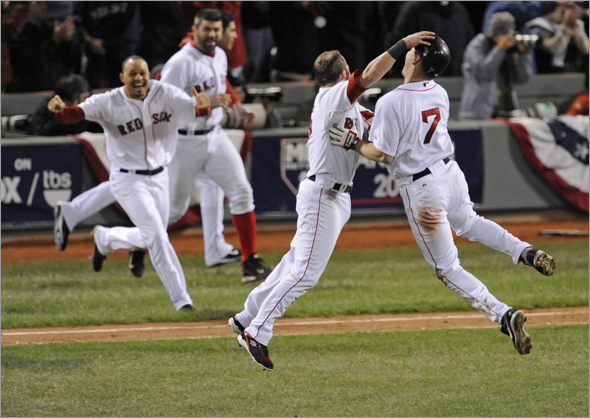 J.D. Drew (7) celebrates with team mates after driving in the winning run in the ninth inning against the Tampa Bay Rays during Game 5 of Major League Baseball's ALCS playoff series in Boston, October 16, 2008.