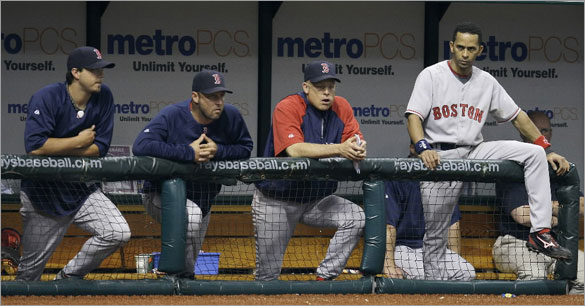 Boston Red Sox's, from left, Josh Beckett, Tim Wakefield, Brad Mills, and Julio Lugo look on in the ninth inning of the Tampa Bay Rays 5-4 win during a baseball game Monday, June 30, 2008 in St. Petersburg, Fla.