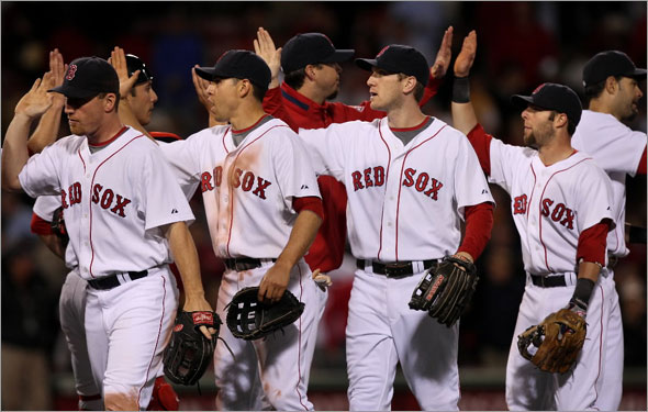 Red Sox vs. Florida Marlins: Red Sox J.D. Drew, Jacoby Ellsbury, Jason Bay and Dustin Pedroia high five after beating the Marlins 8-2.