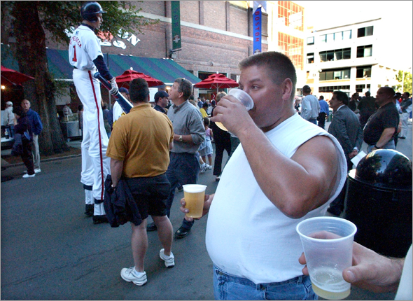 Fan drinking a beer on Yawkey Way 9.5.02