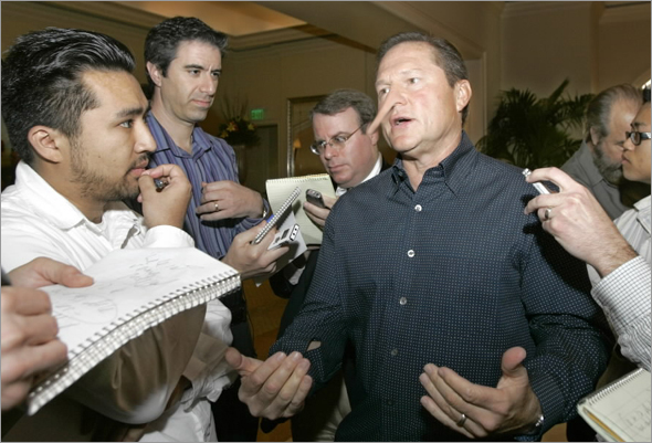 Sports agent Scott Boras is the center of attention as he is surrounded by the media upon his arrival at Major League Baseball's general managers meetings Tuesday Nov. 4, 2008 in Dana Point, Calif.