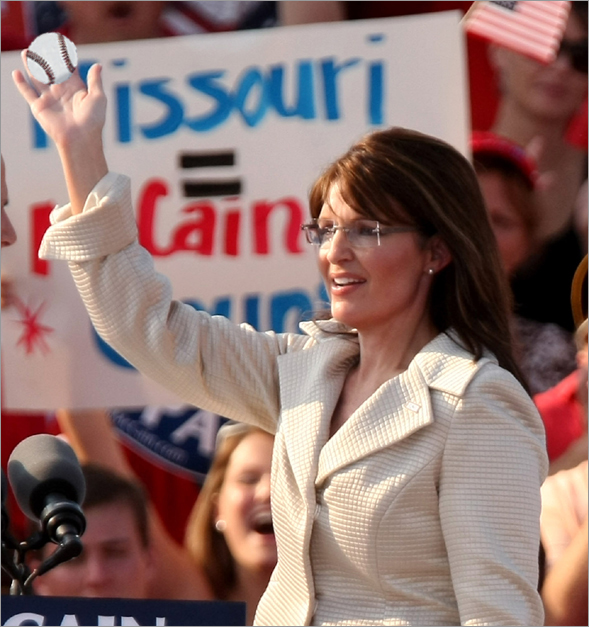 Presumptive Republican presidential nominee Sen. John McCain (R-AZ) and presumptive Republican vice-presidential nominee Alaska Gov. Sarah Palin greet the crowd during a rally August 31, 2008 in O'Fallon, Missouri. The GOP has announced it will suspend most of Monday's Republican National Committee activities in Saint Paul