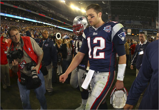 Quarterback Tom Brady #12 of the New England Patriots walks off the field after losing to the New York Giants 17-14 during Super Bowl XLII on February 3, 2008 at the University of Phoenix Stadium in Glendale, Arizona.