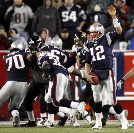 New England Patriots Tom Brady's play fake on his 6-yard touchdown pass to Wes Welker during 3rd quarter action against the Jacksonville Jaguars in the AFC Playoff game at Gillette Stadium on January 12, 2008 in Gillette Stadium.