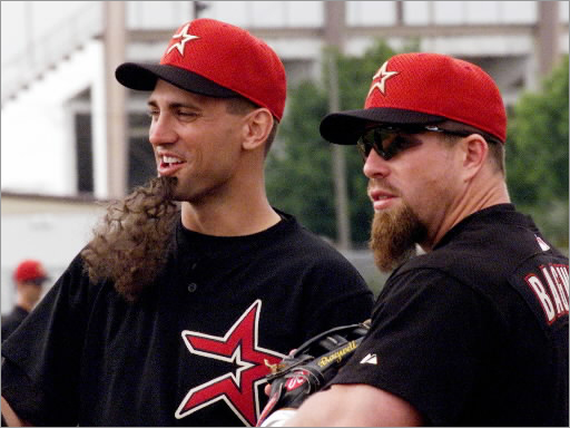 Houston Astros first baseman Tim Bogar (left) wears a fake goatee as he stands with teammate Jeff Bagwell (right) during a workout at their spring training camp in Kissimmee, FL February 23. Several Astros glued on the fake beards to mock Bagwell during the practice.