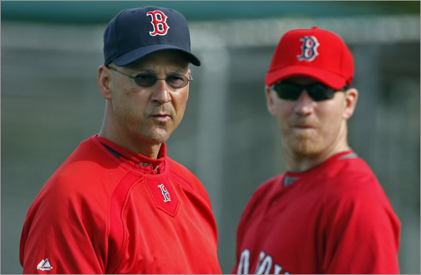 Red Sox manager Terry Francona (left) and outfielder J.D. Drew are seen at a Spring Training workout.