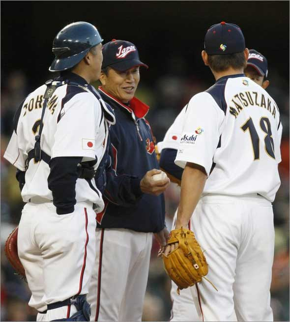 Team Japan's manager Tatsunori Hara takes the ball from Daisuke Matsuzaka (R), as catcher Kenji Johjima watches, in the fifth inning during the semifinals of the World Baseball Classic against Team USA in Los Angeles, California March 22, 2009